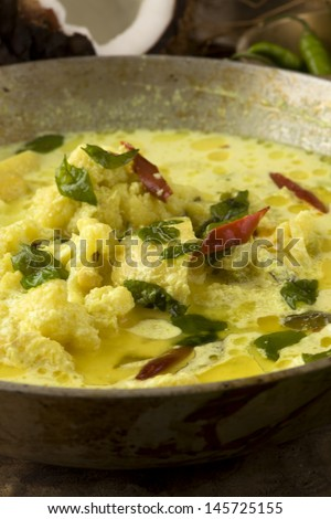 Indian food | South Indian vegetable curry with coconut, cauliflower, potato, turmeric, chili, and curry leaves