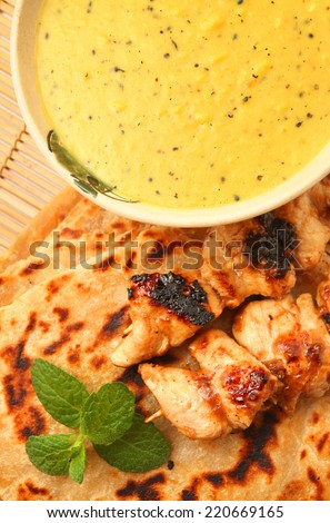 Indian foods Dal with Paratha and marinated chicken skewer - stock photo