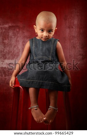 Indian girl child in a red background - stock photo