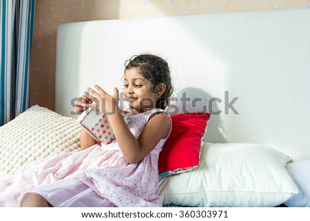 Indian girl got a present - stock photo