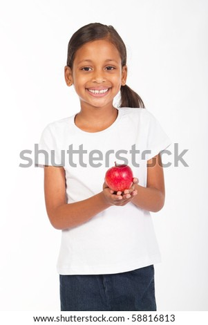 indian girl holding a red apple - stock photo