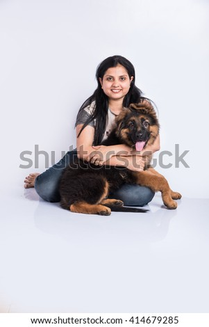 indian girl holding German shepherd puppy isolated on white background, asian girl and German shepherd puppy