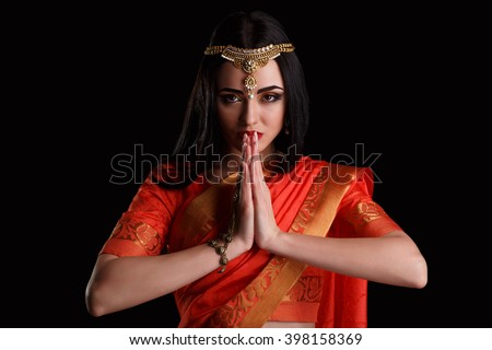 Indian girl in inviting posture. caucasian girl with orange sari and jewelery in welcome posture. Namaste: Beautiful Girl Bollywood dancer (Bellydancer) in Sari. Eastern fairy tale - stock photo