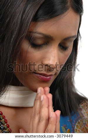 Indian Girl In Prayer Against A White Background Stock