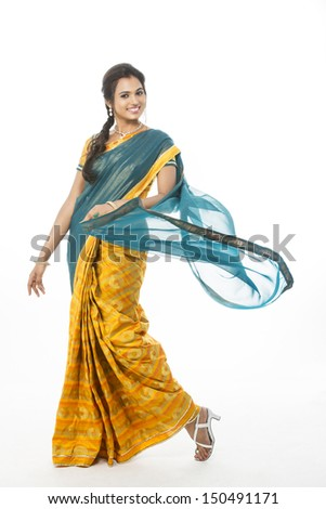 Indian girl in traditional Indian sari posing on white background. - stock photo