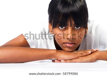 indian girl lying on floor - stock photo