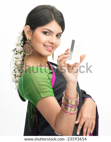 Indian girl posing with the credit card - stock photo