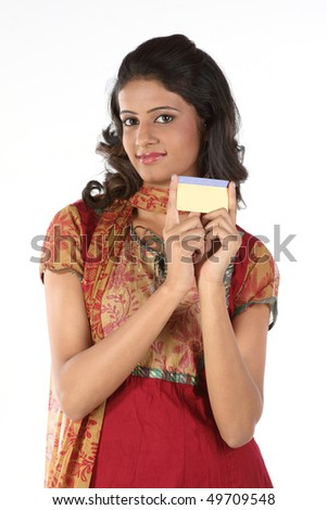 Indian girl showing gold card - stock photo