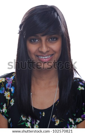 Indian girl smiling with brace - stock photo