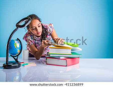 indian girl studying, cute little indian girl doing home work, asian girl studying - stock photo