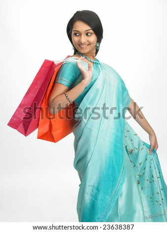 Indian girl with colorful shopping bags - stock photo
