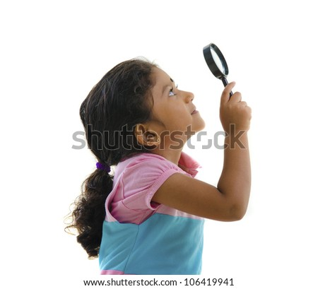 indian girl with magnifying glass - stock photo