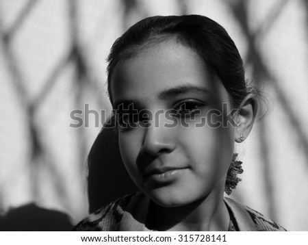 Indian girl with sunlight shadow - stock photo
