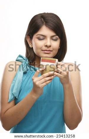 Indian girl with the yellow cup - stock photo