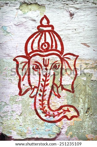 Indian god Ganesha on the vintage wall in Delhi - stock photo
