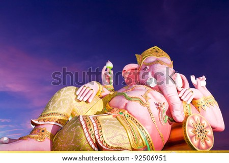"Indian god ""Ganesha"" statue in twilight in Thailand tilted"