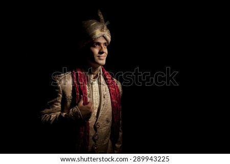 Indian groom in traditional attire - stock photo
