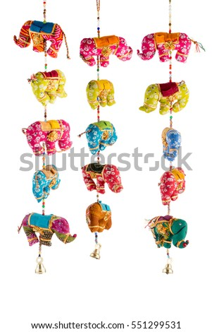 Indian handmade wind chimes with bells and decorated toy elephant model. Decorative hangings with mirror and bead work.