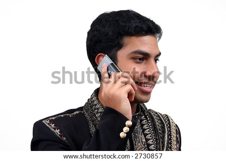 Indian in traditional clothing talking in a phone 1 - stock photo