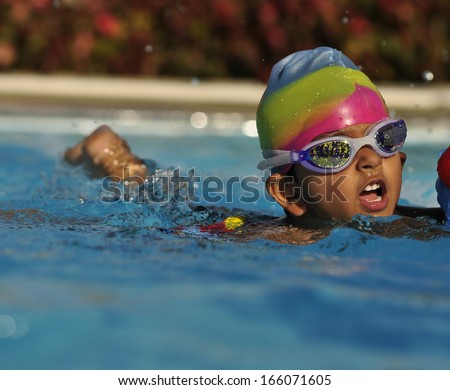 Indian Kid in the swimming pool - stock photo