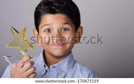 Indian kid with an award in his hand. - stock photo