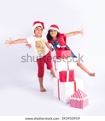 indian kids with christmas gifts, asian kids with christmas gifts, isolated on white background, closeup