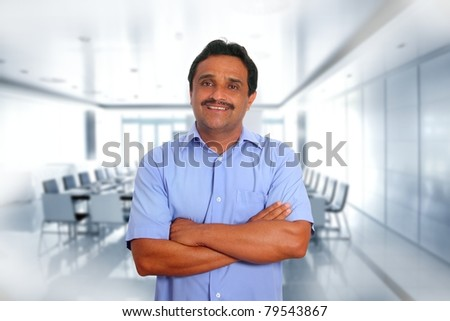 Indian latin businessman blue shirt in boardroom office background [Photo Illustration] - stock photo