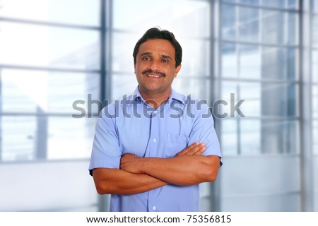 Indian latin businessman blue shirt in modern office background [Photo Illustration] - stock photo