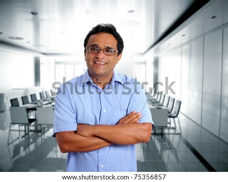 indian latin businessman glasses blue shirt in boardroom office [Photo Illustration] - stock photo