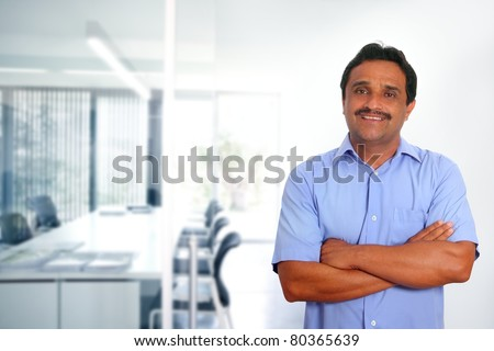 Indian latin businessman with blue shirt in modern office background [Photo Illustration] - stock photo