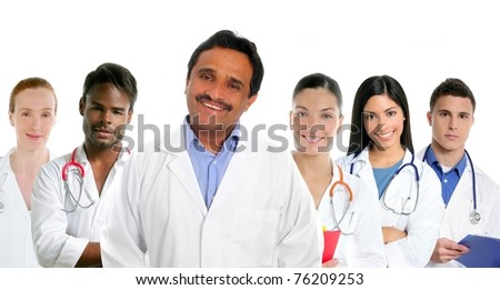Indian latin expertise doctor multi ethnic doctors nurse in background [Photo Illustration] - stock photo