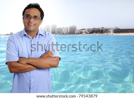 Indian latin tourist man in tropical caribbean turquoise beach [Photo Illustration] - stock photo