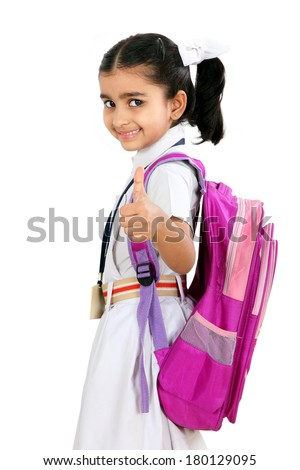 Indian little school girl is  showing thumb up sign.Isolated on white background. - stock photo