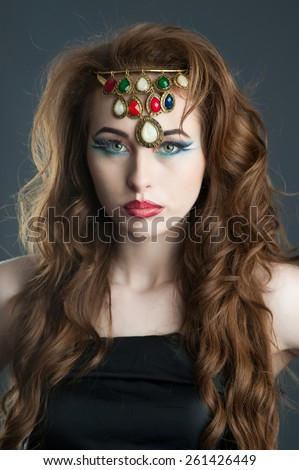 Indian look like woman with necklace on head.  - stock photo