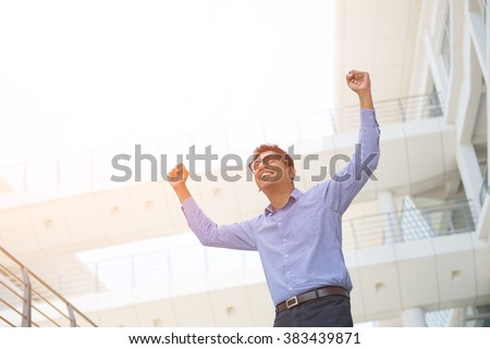 indian male business man celebrating success