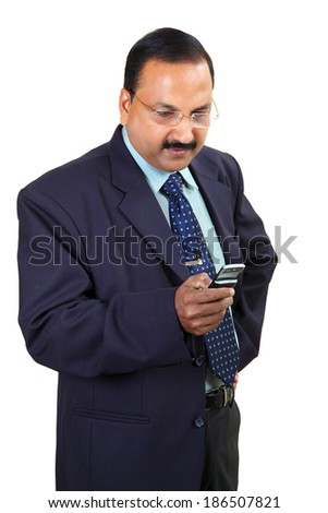indian male business man using smartphone with white background - stock photo