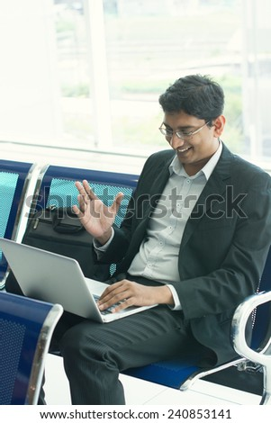 indian male business man working from airport terminal - stock photo