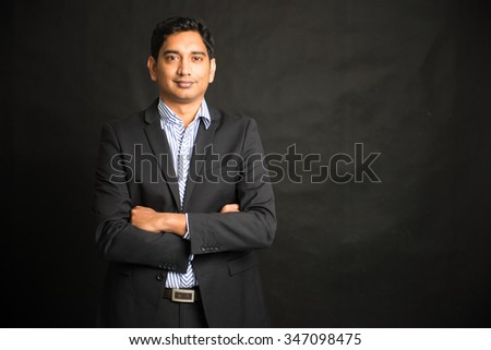 indian male businessman black background - stock photo