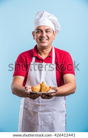 indian male chef tasting indian snack samosa, asian male chef cook and food in plate