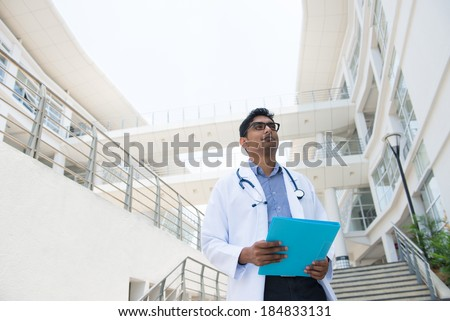 indian male doctor with hospital background - stock photo