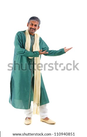 indian male in dhoti dress, full body welcome gesture - stock photo
