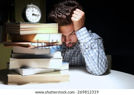 Indian male student tensed due to exams. - stock photo