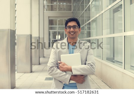indian male using laptop outdoor