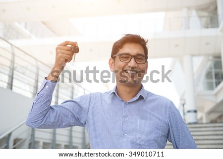 indian male with car keys - stock photo