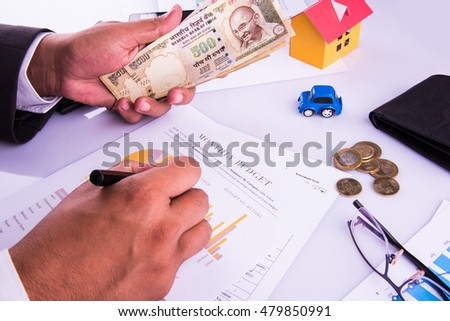 indian man planning monthly budget or account expenses