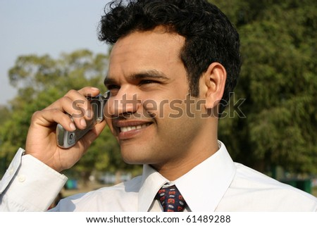 Indian man talking on mobile phone - stock photo