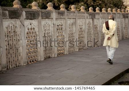 Indian man walking down the street - stock photo
