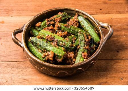 Indian masala fried bhindi or ladyfinger, curry, side dish with chapati, roti, naan, poori  - stock photo