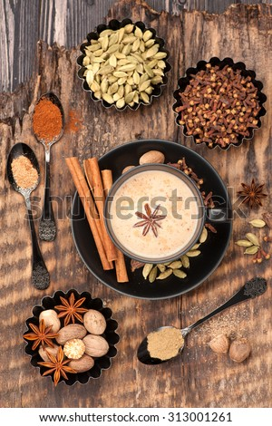 Indian masala tea with spices. Tea with milk and spicy - stock photo