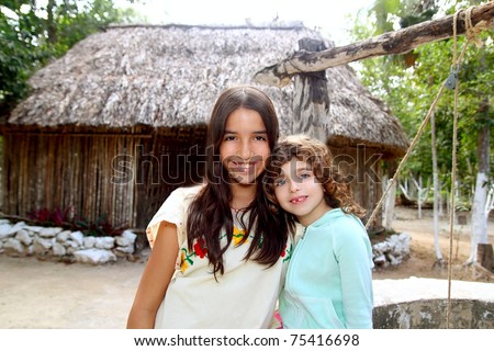 Indian mayan latin girl with her caucasian friend varied ethnicity - stock photo
